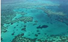 This photo taken on November 20, 2014 shows an aerial view of the Great Barrier Reef off the coast of the Whitsunday Islands, along the central coast of Queensland. Picture: AFP.