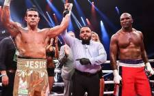 Former UFC champion Vitor 'The Phenom' Belfort defeats former heavyweight world champion Evander 'The Real Deal' Holyfield in a boxing match. Picture: tomorrowsboxing/Instagram.