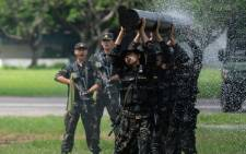 People's Liberation Army soldiers display their skills at an airbase in Hong Kong on 30 June 2018, during an event to mark the 21st anniversary of the Hong Kong handover to China. Picture: AFP