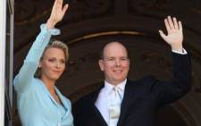 Prince Albert II of Monaco and Princess Charlene of Monaco greet people on the balcony after their civil wedding at the Prince's Palace on 1 July 2011. Picture: AFP