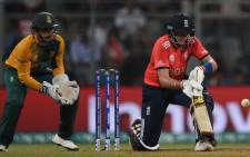 South Africa's Quinton de Kock (L) looks on as England's Joe Root plays a shot during the World T20 cricket tournament match between England and South Africa at The Wankhede Stadium in Mumbai on 18 March 2016. Picture: AFP.