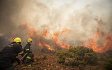 Firefighters battle a veld fire in Scarborough. Picture: Thomas Holder/EWN