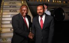 President Cyril Ramaphosa welcomed by Ethiopian Prime Minister Abiy Ahmed upon his arrival in Addis Ababa for the 33rd AU Summit. Picture: Twitter/Presidency