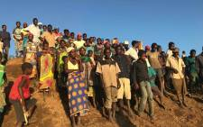 People from villages along the Buzi River wait for relief boats after Cyclone Idai hit Mozambique. Picture: Christa Eybers/EWN