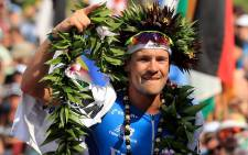 Patrick Lange of Germany celebrates after winning the IRONMAN World Championship and setting a course record of 8:01.39 beating Craig Alexander's 2011 record of 8:03.56 on October 14, 2017 in Kailua Kona, Hawaii. Picture: AFP.