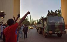 People cheer Senegalese ECOWAS (Economic Community of West African States) soldiers as they arrive at the Statehouse in Banjul on January 22, 2017. Picture: AFP