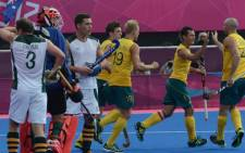 Australia's players celebrate scoring a goal against South Africa during their London 2012 Olympic Games. Picture: AFP.