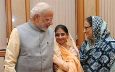 Indian Prime Minister Narendra Modi (L) meets with a mute and deaf Indian woman known as Geeta who strayed into Pakistan more than a decade ago who finally returned to her home country. Picture: AFP.