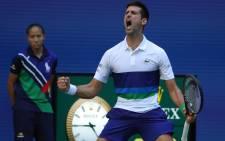Serbia's Novak Djokovic celebrates a point against Japan's Kei Nishikori during their 2021 US Open Tennis tournament. Picture: AFP