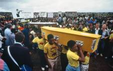 Mourners carrying coffins of those who were killed by the South African police at Langa township in Uitenhage on 21 March 1985. Picture: UN Photo