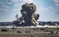 Smoke billows after shelling on the Islamic State group's last holdout of Baghouz, in the eastern Syrian Deir Ezzor province on 3 March 2019. Picture: AFP