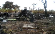 The burnt wreckage of a Mozambican Airlines plane at the site of its crash in Namibia's Bwabwata National Park on 30 November, 2013. Picture: AFP