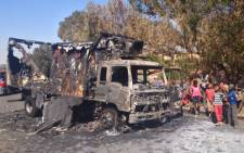 File pic: A truck which was burnt outside the Albany bakery in Germiston in September, allegedly by striking Satawu members. Picture: Twitter.