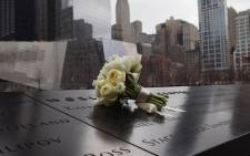 A bouquet of roses lies at the World Trade Center Memorial after being placed by Samantha Cameron, wife of British Prime Minister David Cameron on March 15, 2012 in New York. Picture: AFP.
