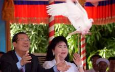 Cambodia's Prime Minister Hun Sen and his wife Bun Rany led a massive rally on 7 January marking the anniversary of the fall of the murderous Khmer Rouge regime, seizing the opportunity to burnish his reputation as the saviour of the nation. Picture: AFP.