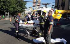 Paramedics prepare to airlift a man who fell from a building in Sandton to hospital on 20 February 2013. Picture: Mbali Sibanyoni/EWN