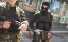 FILE: Pro-Russian militant stand guard in front of the occupied Ukraine Security Service building on 21 April, 2014 in Slovyansk, Ukraine. Picture: AFP.