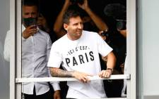 Argentinian football player Lionel Messi leans in a window as he salutes supporters after he landed on 10 August 2021 at Le Bourget airport, north of Paris, to become Paris Saint-Germain's new player following his departure from Barcelona, the club he has represented for the entirety of his 17-year professional career so far. Picture: Sameer Al-Doumy / AFP