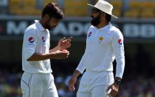Pakistan bowler Mohamed Amir and team captain Misbah-ul-Haq plot their tactics. Picture: AFP