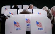 People cast their ballots at a community centre during early voting in Potomac, Maryland, two weeks ahead of the key US midterm polls. Picture: AFP.