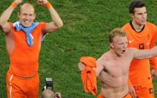 Netherlands players Arjen Robben (L), Dirk Kuyt (C) and Nigel de Jong celebrate after qualifying for the 2010 World Cup final. Picture: AFP