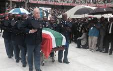 FILE: Senzo Meyiwa's body being wheeled out of Moses Mabhida Stadium. Picture: Marc Lewis/EWN