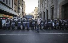 FILE. Police get into formation in the streets outside Parliament. Picture: Thomas Holder/EWN
