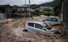 A picture shows cars trapped in the mud after floods in Saka, Hiroshima prefecture on 8 July, 2018. Picture: AFP.