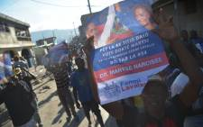Supporters of losing presidential candidate Maryse Narcisse march in the Haitian capital Port-au-Prince, on November 29, 2016, to protest the election of Jovenel Moise as new president of Haiti. Picture: AFP
