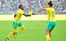 Banyana Banyana's Thembi Kgatlana (L) and Leandra Smeda (R) celebrate after winning the Cosafa Women's Championship against Zimbabwe at the Barbourfields Stadium on 24 September 2017. Picture: safa.net
