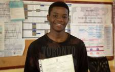 Prince Dlomo from Orlando Secondary School achieved one distinction and six B's. He says he's slightly disappointed at not getting more distinctions. He plans to study computer science and 'change the world with it'. Picture: Ahmed Kajee/EWN