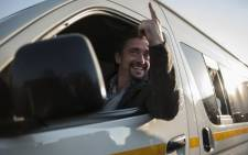 Former Top Gear co-host Richard Hammond gestures as he arrives at the Ticketpro Dome for the Clarkson, Hammond and May Live Show held in Johannesburg on 10 June, 2015. Picture: AFP.