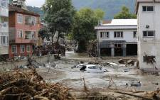 This handout picture released by Turkey's IHH humanitarian aid group on 12 August 2021 shows a car floating in water in Kastamonu, after flash floods swept across several Black Sea regions. Picture: Handout / IHH / AFP.