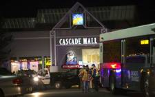Police attend the Cascade Mall after three women were reportedly shot dead and a man critically injured following a shooting at the shopping center on September 23, 2016 in Burlington, Washington. The suspect is believed to still be at large. Picture: AFP.