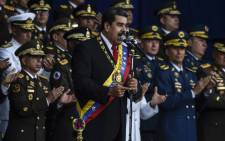 """Venezuelan President Nicolas Maduro delivers a speech during a ceremony to celebrate the 81st anniversary of the National Guard in Caracas on August 4, 2018. Maduro was unharmed after an exploding drone """"attack"""", the minister of communication Jorge Rodriguez said following the incident. Picture: AFP"""