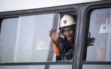 A miner waves from a window of a bus after being rescued from Sibanye-Stillwater's Beatrix mine shaft 3. Picture: Thomas Holder/EWN.