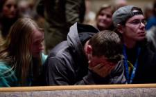 People gather and pray at Center Point Church following a mass shooting on 21 February 2016, in Kalamazoo, Michigan. Picture: AFP/Tasos Katopodis