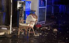 A chair is pictured in the rubbles of a gas station after earthquakes in the village of Visso, central Italy, on 26 October 2016. Picture: AFP.