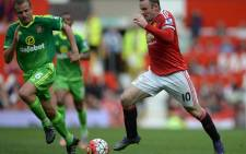 Manchester United's English striker Wayne Rooney (R) vies with Sunderland's English midfielder Lee Cattermole during the English Premier League football match between Manchester United and Sunderland at Old Trafford in Manchester, north west England, on September 26, 2015. Manchester United won the game 3-0. Picture: AFP.