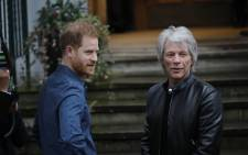 Britain's Prince Harry, Duke of Sussex, chats with US singer Jon Bon Jovi as he arrives at Abbey Road Studios in London on February 28, 2020, where they met with members of the Invictus Games Choir, who were there to record a special single in aid of the Invictus Games Foundation. Picture: AFP.
