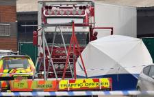 A lorry, believed to have originated from Bulgaria, and found to be containing 39 dead bodies, is pictured inside a Police cordon at Waterglade Industrial Park in Grays, east of London, on 23 October 2019. Picture: AFP