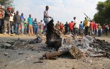 FILE: Smoldering branches lay in the streets of Kya Sand after residents protested over service delivery issues on 12 October 2015. Picture: Reinart Toerien/EWN.