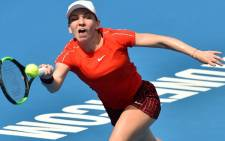 Simona Halep of Romania hits a return against Australia's Ashleigh Barty during their women's singles second round match at the Sydney International tennis tournament in Sydney on 9 January 2019. Picture: AFP
