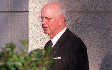 FILE: Former apartheid-era State President PW Botha leaves the Magistrates Court in George  on 1 June 1998 on the first day of the resumption of his trial. He was charged with ignoring three subpoenas to testify before the Truth and Reconciliation Commission. Picture: AFP.