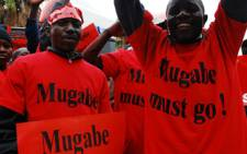 Protesters demonstrate against Zimbabwean President Robert Mugabe. A number of organisations have expressed concern over the transparency of Zimbabwe's upcoming elections on 31 July. Picture: EWN