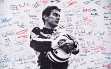 A poster bearing a photo of Brazilian F1 driver Ayrton Senna signed by fans is displayed during a ceremony on 1 May 2019 marking the 25th anniversary of his death at the Imola circuit during the 1994 San Marino Grand Prix. Picture: AFP