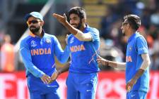 FILE: India's Jasprit Bumrah (centre) celebrates with India's captain Virat Kohli (left) and teammates after taking the wicket of Bangladesh's Soumya Sarkar for 25 during the 2019 Cricket World Cup warm-up match between Bangladesh v India at Sophia Gardens stadium in Cardiff, south Wales, on 28 May 2019. Picture: AFP