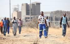 Mine workers walk to a meeting point, at Lonmin's Marikana Mine. Picture: Taurai Maduna/EWN.