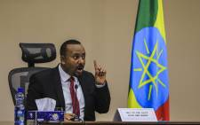 Ethiopian Prime Minister Abiy Ahmed gestures at the House of Peoples Representatives in Addis Ababa, Ethiopia, on 30 November 2020 to respond to the Parliament on the current conflict between Ethiopian National Defence Forces and the leaders of the TPLF. Picture: AFP.