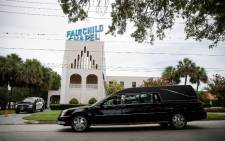 "A Hearse drives past Baldwin-Fairchild Funeral Home where a wake for Christopher ""Dru"" Leinonen was taking place, 17 June, 2016 in Orlando, Florida. Picture: AFP."
